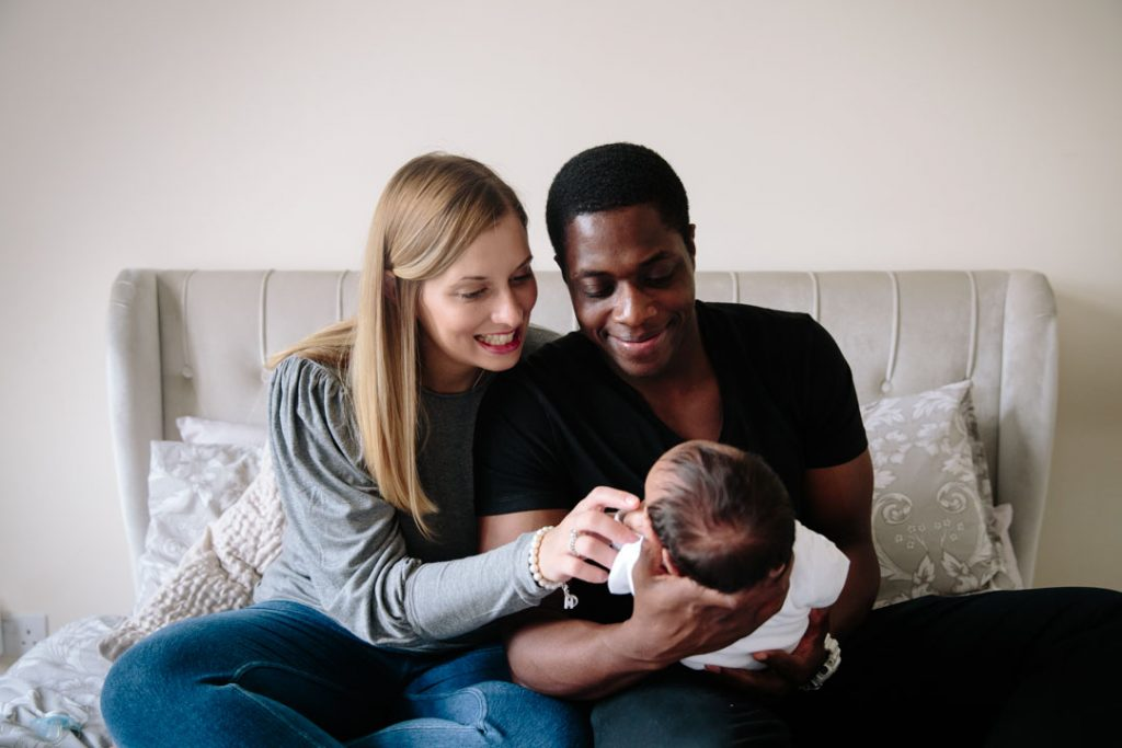 Mum and Dad smiling at newborn baby boy