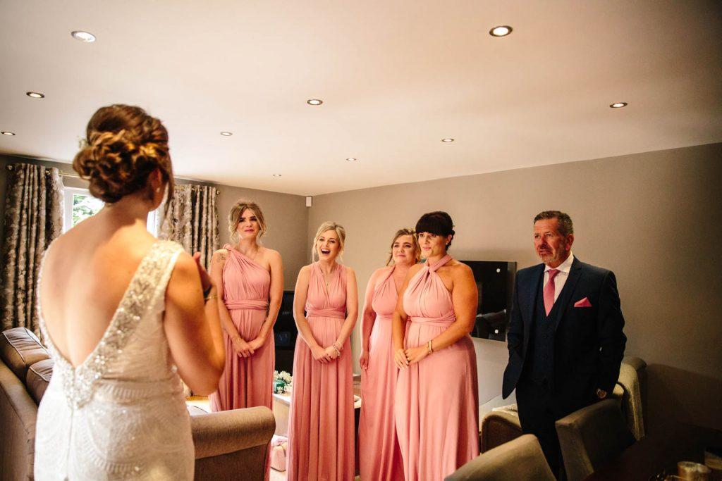 Bride reveals wedding dress to Dad and bridesmaids