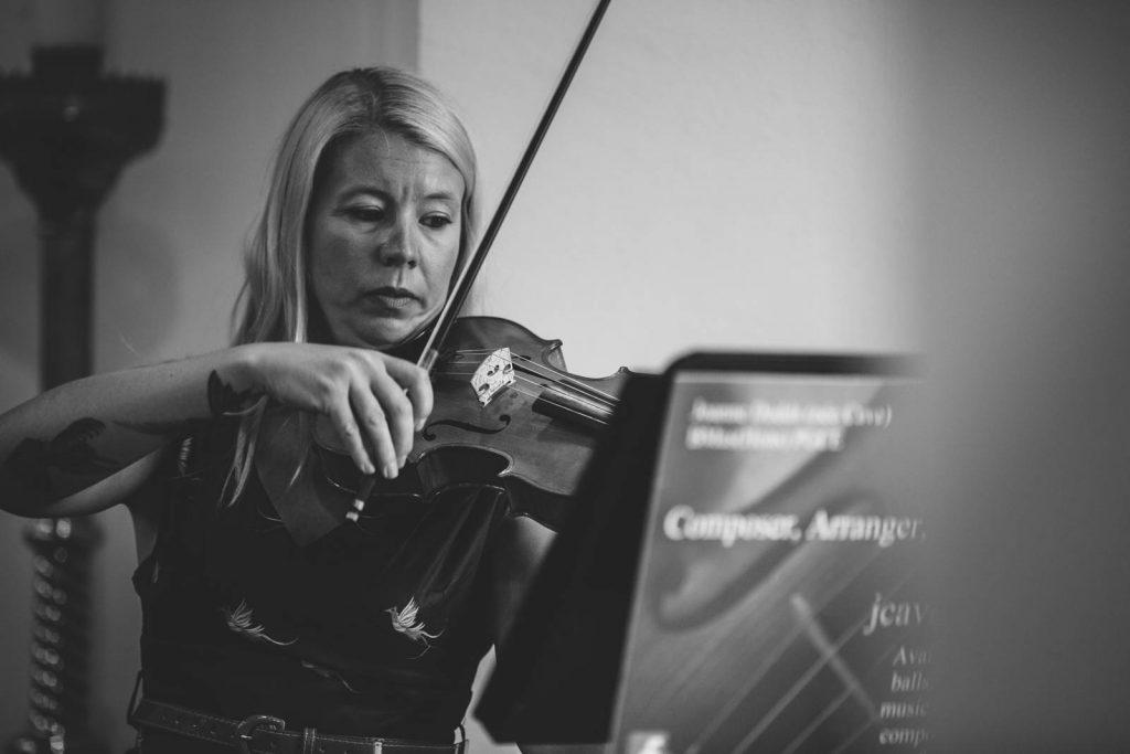Violin player at church wedding