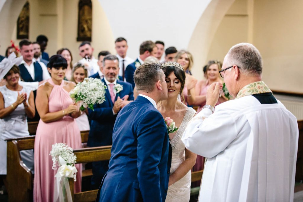 groom kissing bride- first kiss as husband and wife