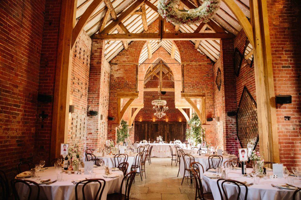 Wedding breakfast tables set up ready for Shustoke Barn wedding