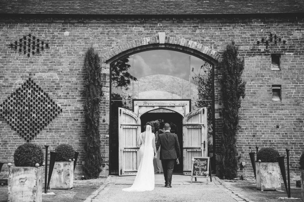 bride and groom arriving at Shustoke Barn