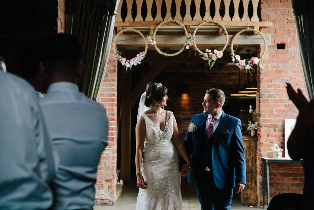 bride and groom announced into wedding breakfast