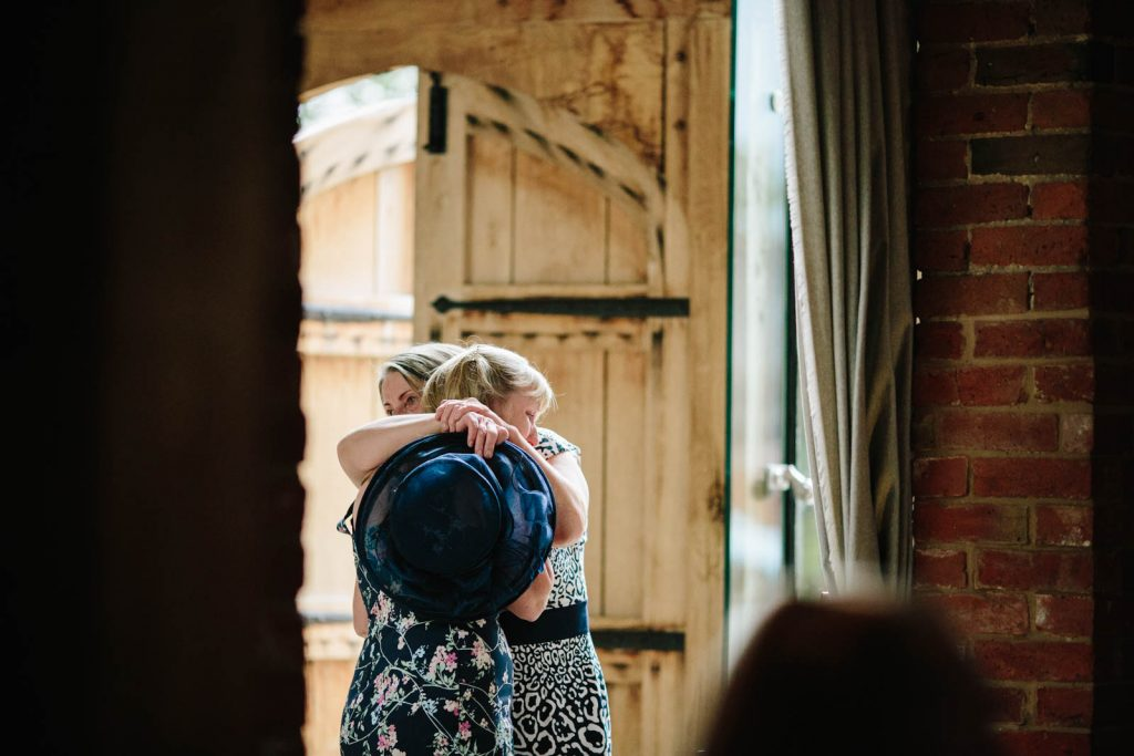 guest emotionally hugging at wedding