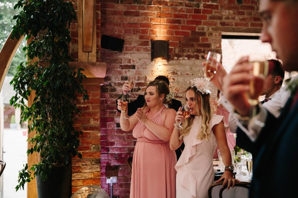 wedding guests raising a toast to speeches
