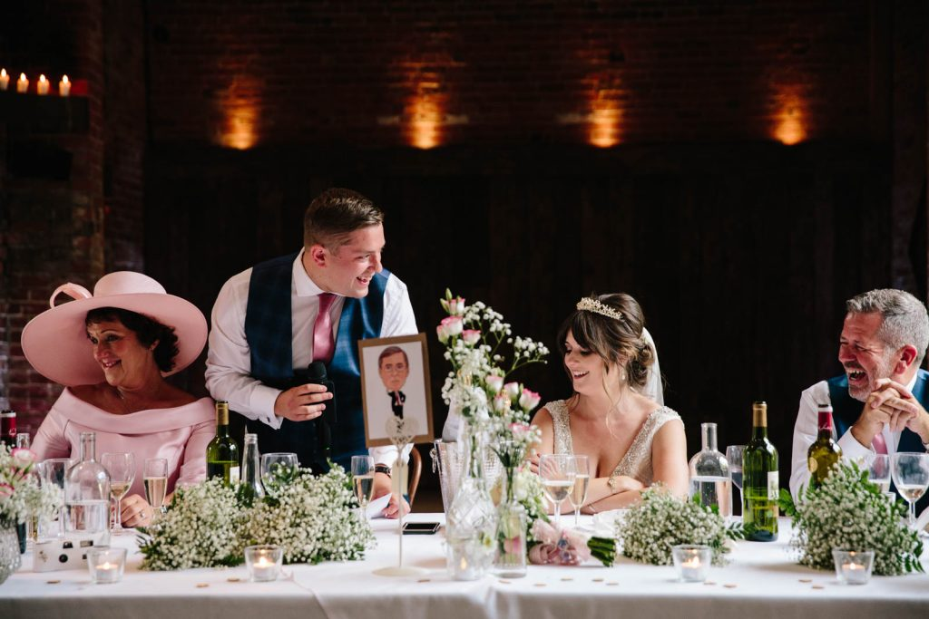 Wedding party laughing at speeches on top table