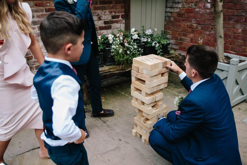Wedding guests playing giant jenga
