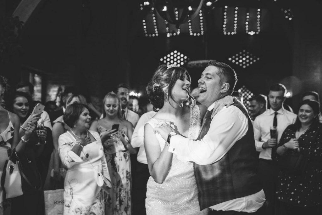bride and groom dancing their first dance at shustoke barn wedding