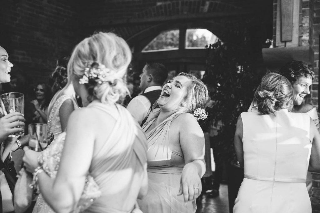bridesmaid laughing on wedding dancefloor