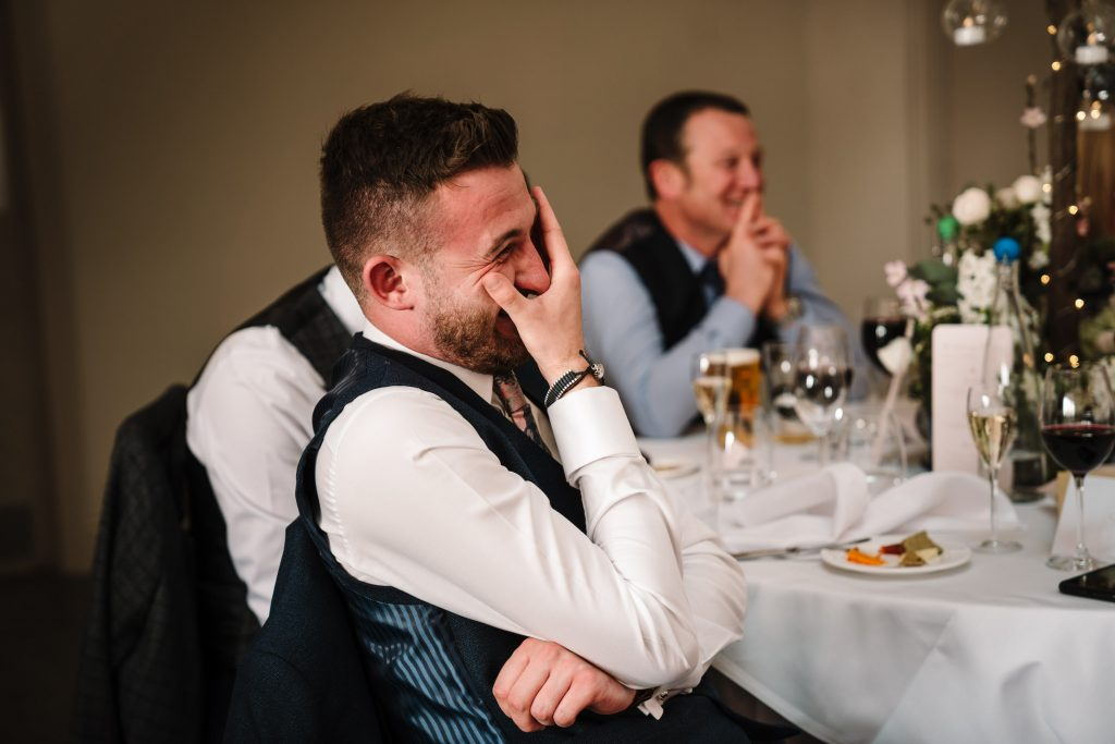 Guest laughing at speech during blackwell grange wedding