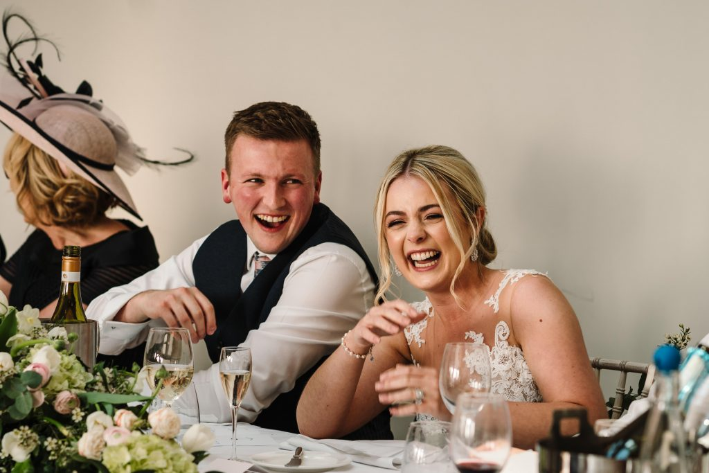 bride and groom laughing during wedding speeches, blackwell grange
