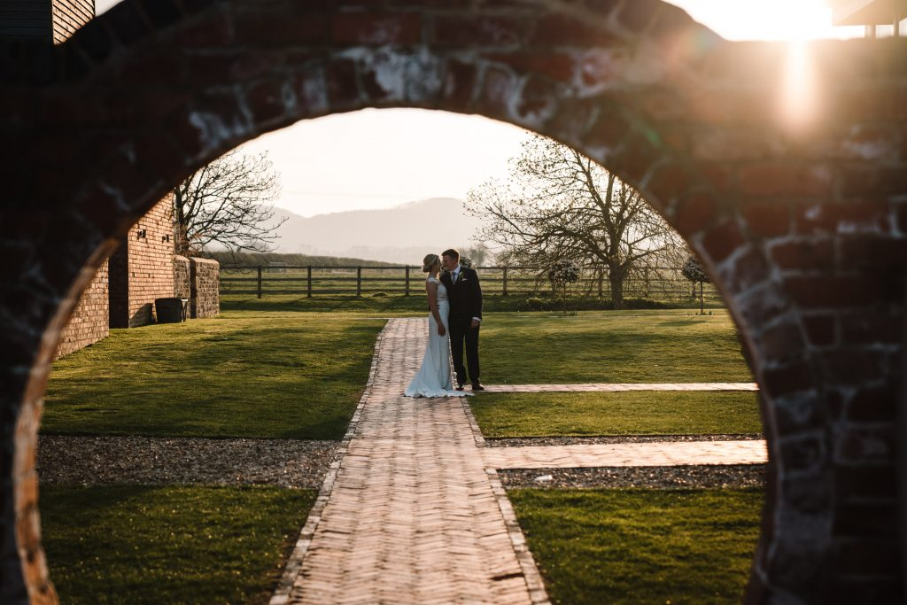 bride and groom standing along the path at blackwell grange wedding