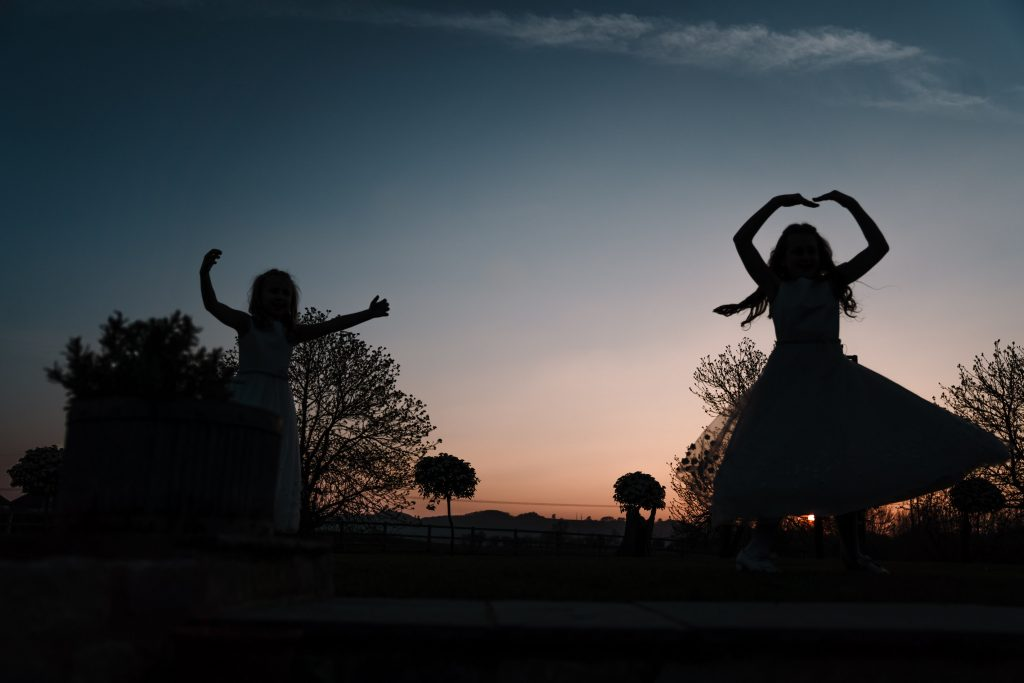 silhouette of girls dancing outside at blackwell grange wedding