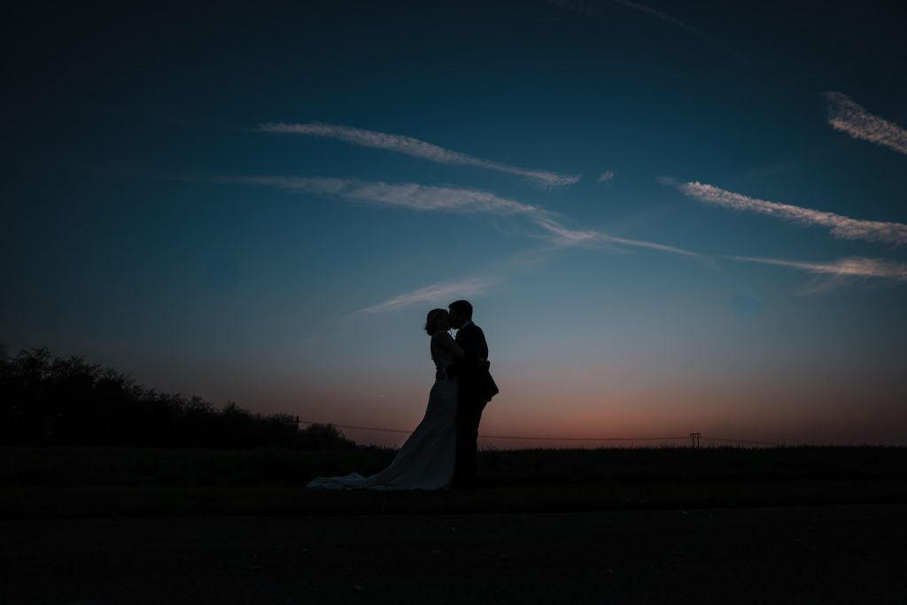 silhouette of bride and groom in the sunset at blackwell grange wedding
