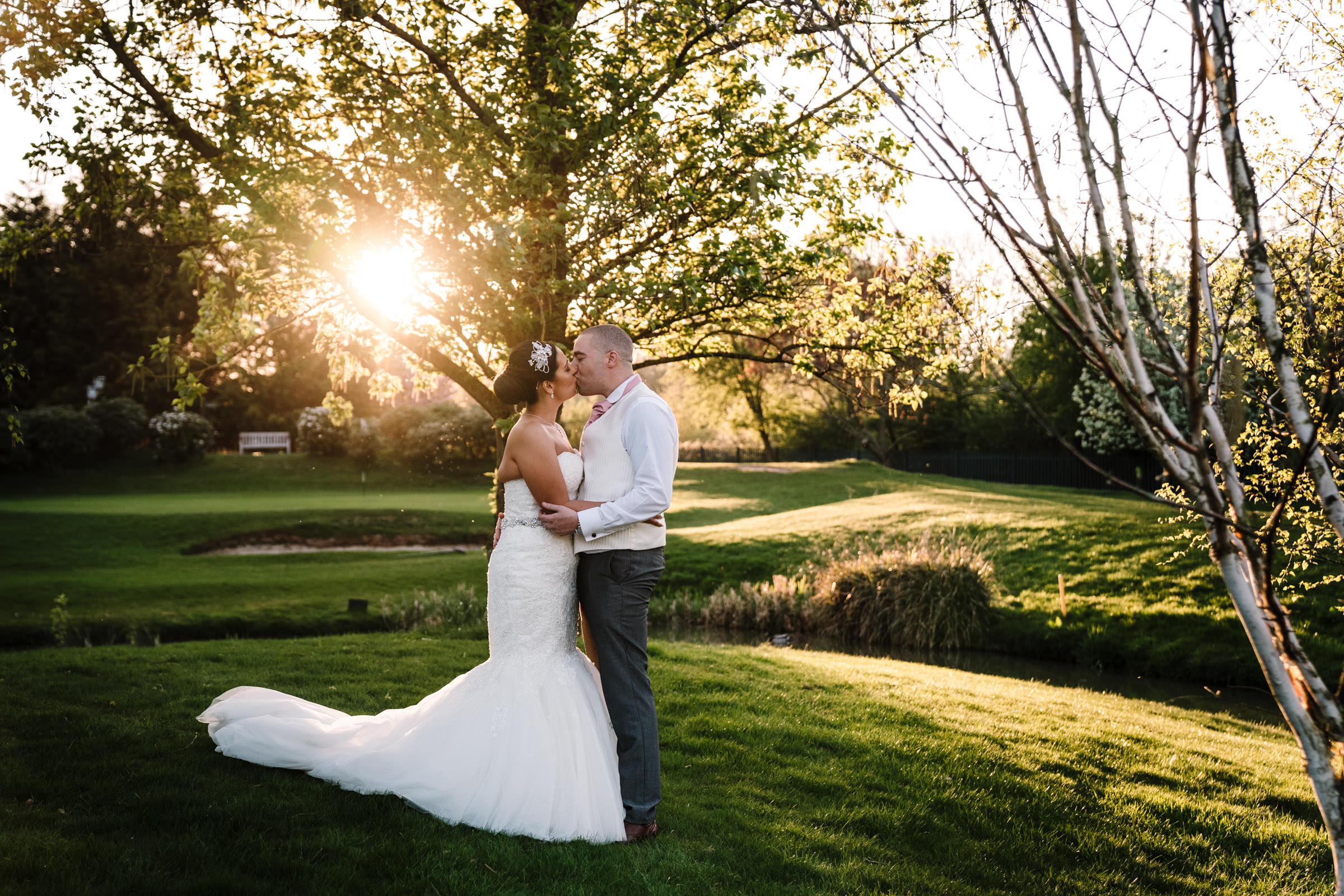 bride and groom standing in the sunset, nailcote hall