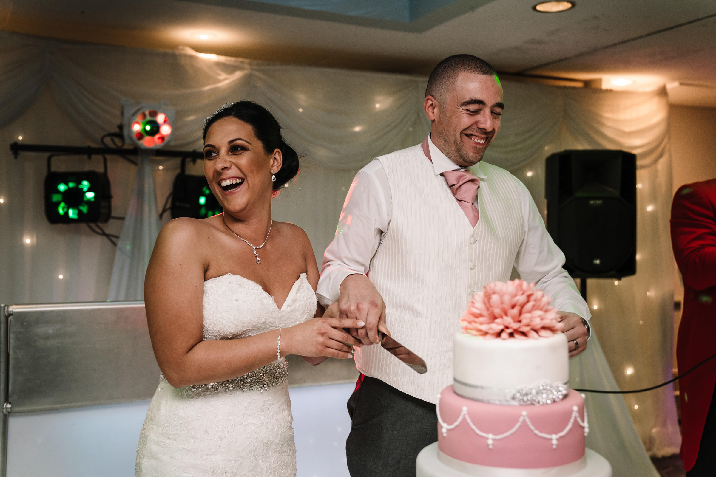 bride & groom cutting the cake at nailcote hall wedding