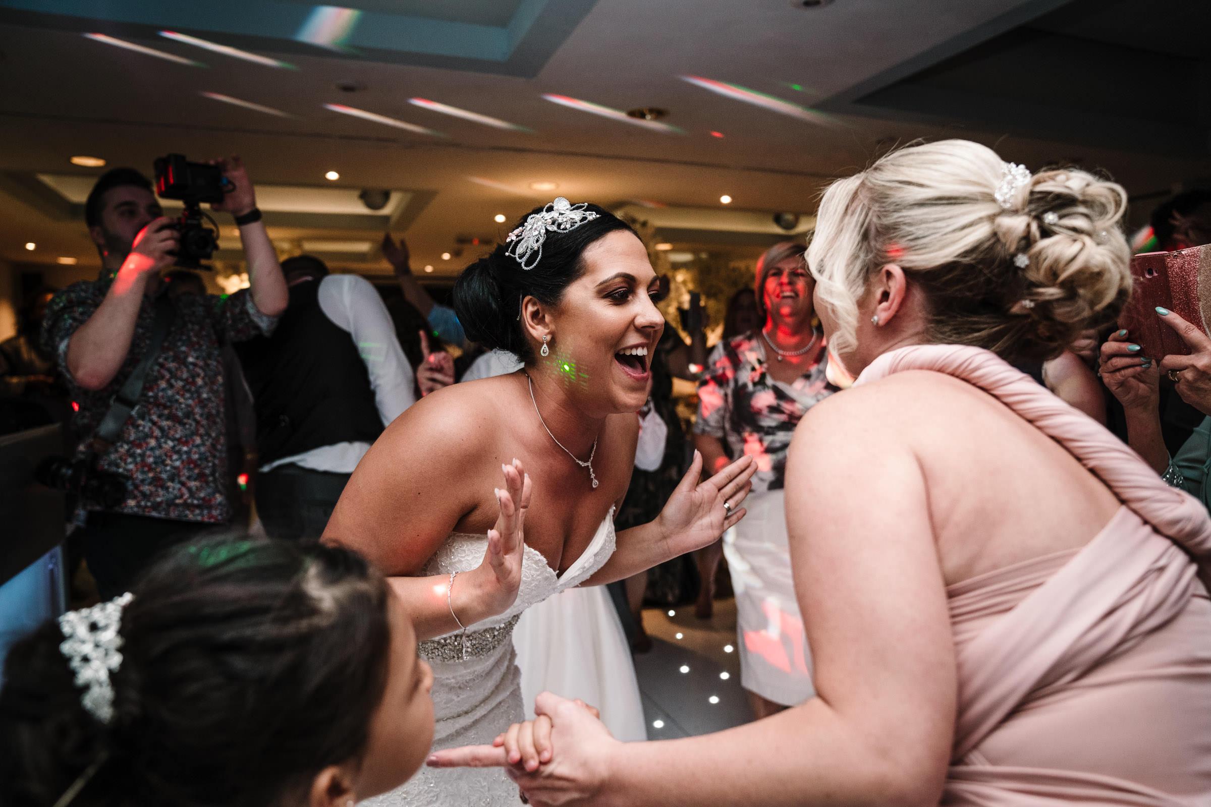 bride dancing with bridesmaid, nailcote hall wedding