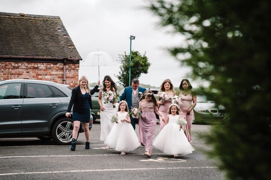 bridal party walking over to wedding ceremony, royal arms hotel wedding