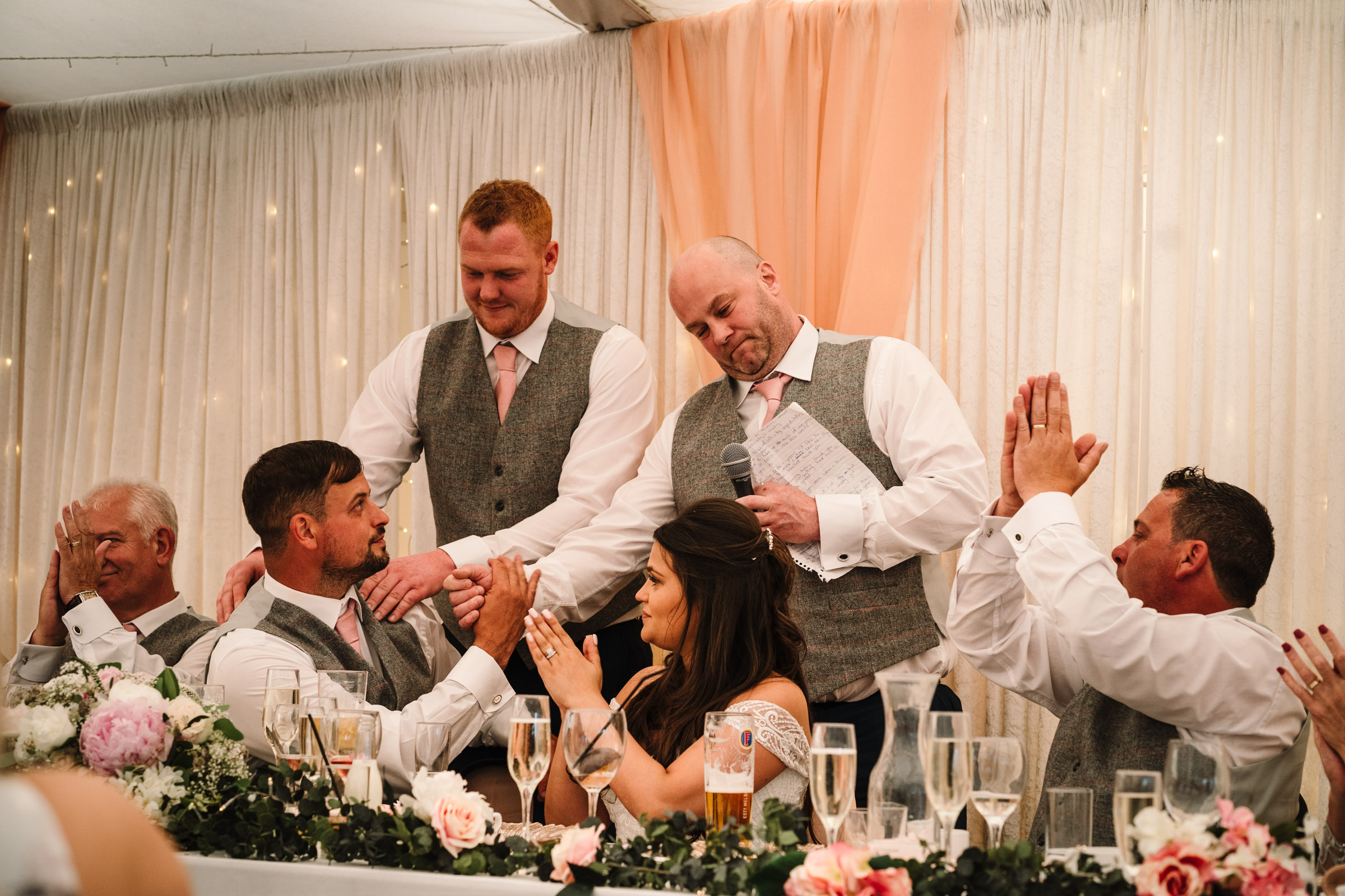 Best men and groom during speeches, royal arms hotel