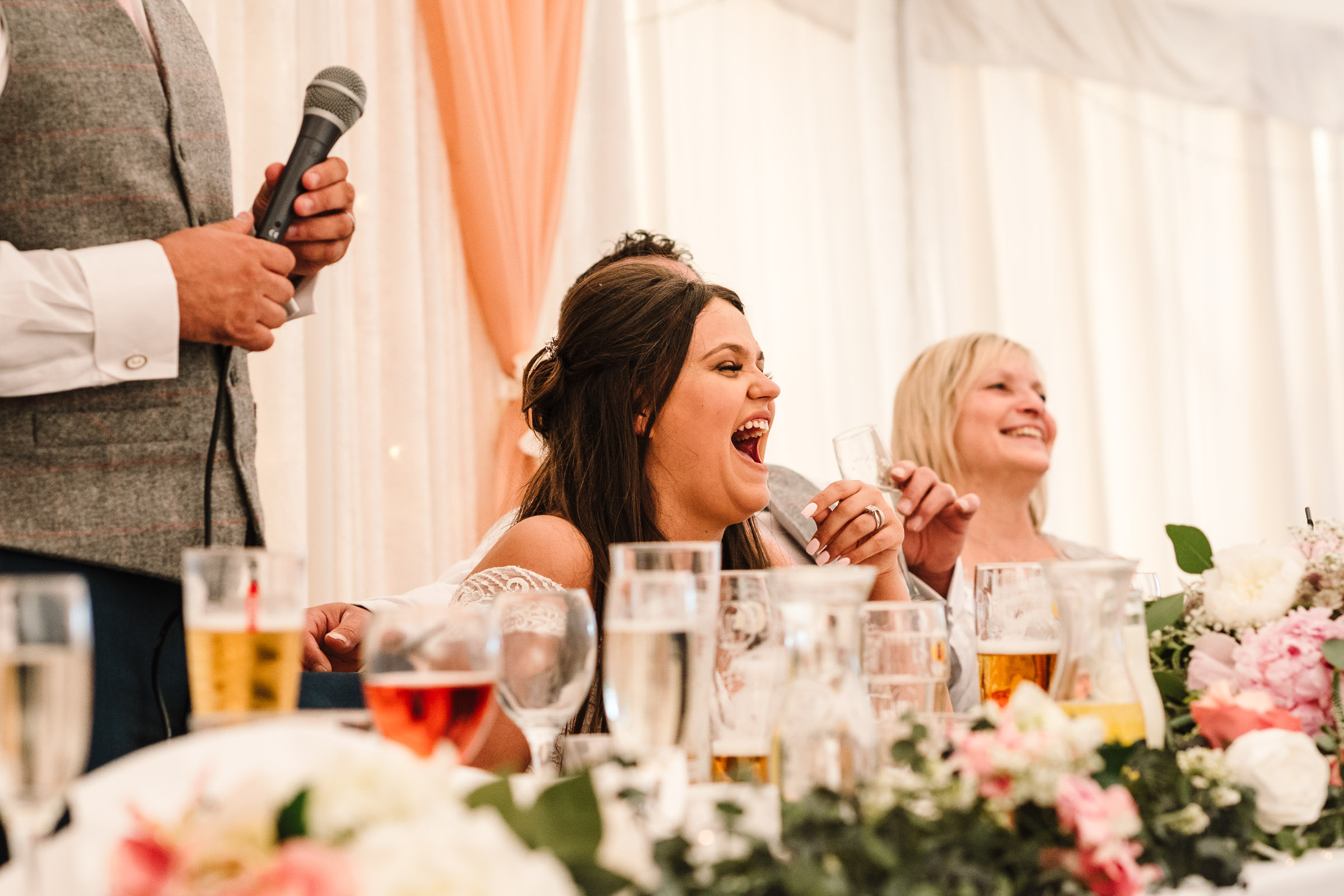 bride laughing during speeches, royal arms hotel wedding