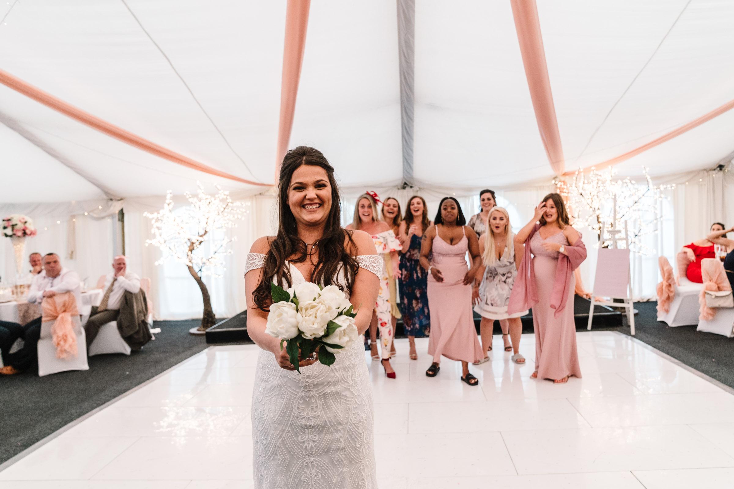 bride throwing wedding bouquet, royal arms hotel