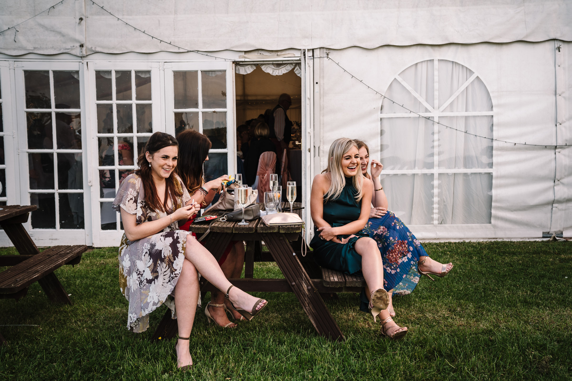 guests sitting outside marquee during royal arms hotel wedding