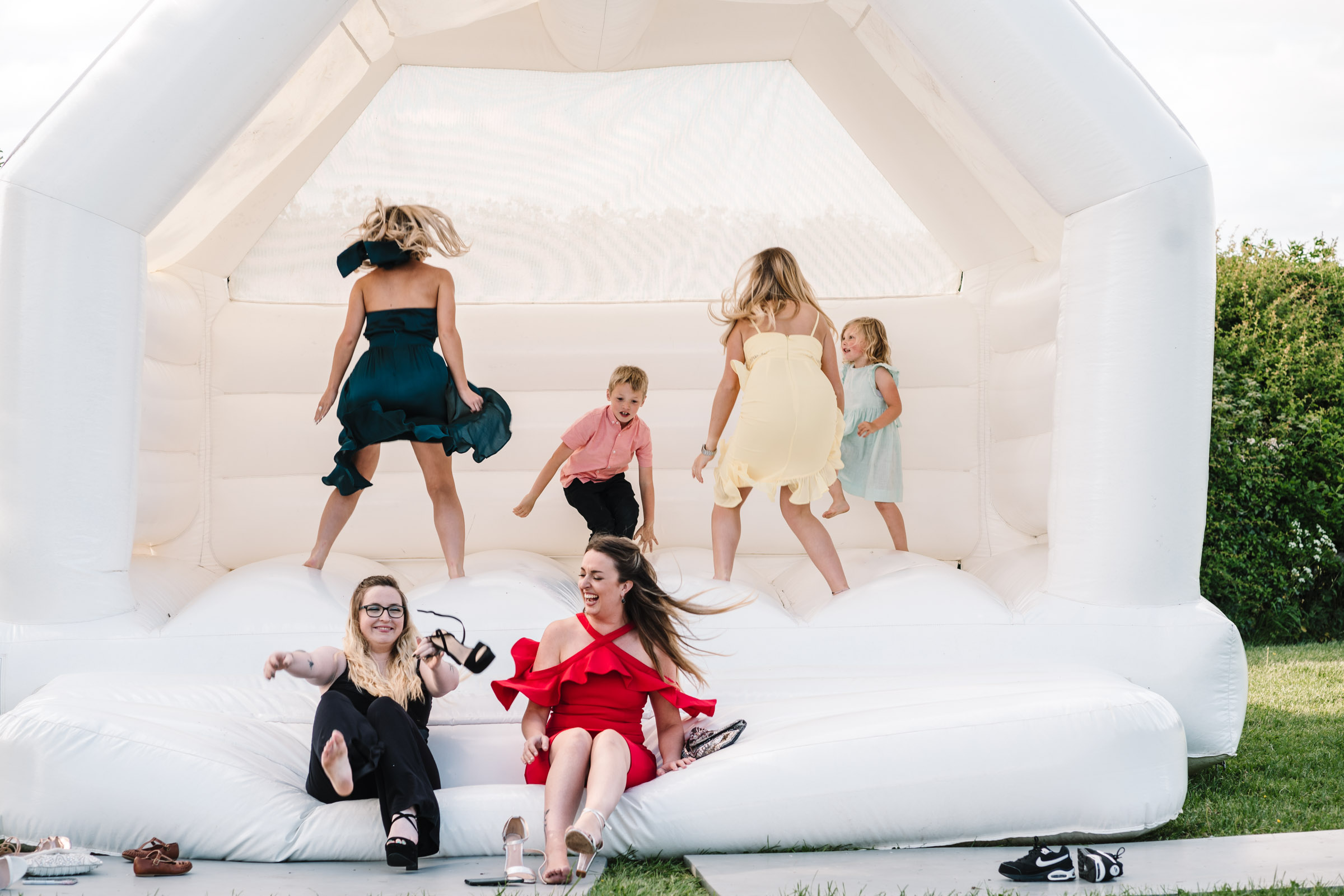 guests bouncing on bouncy castle, royal arms hotel wedding