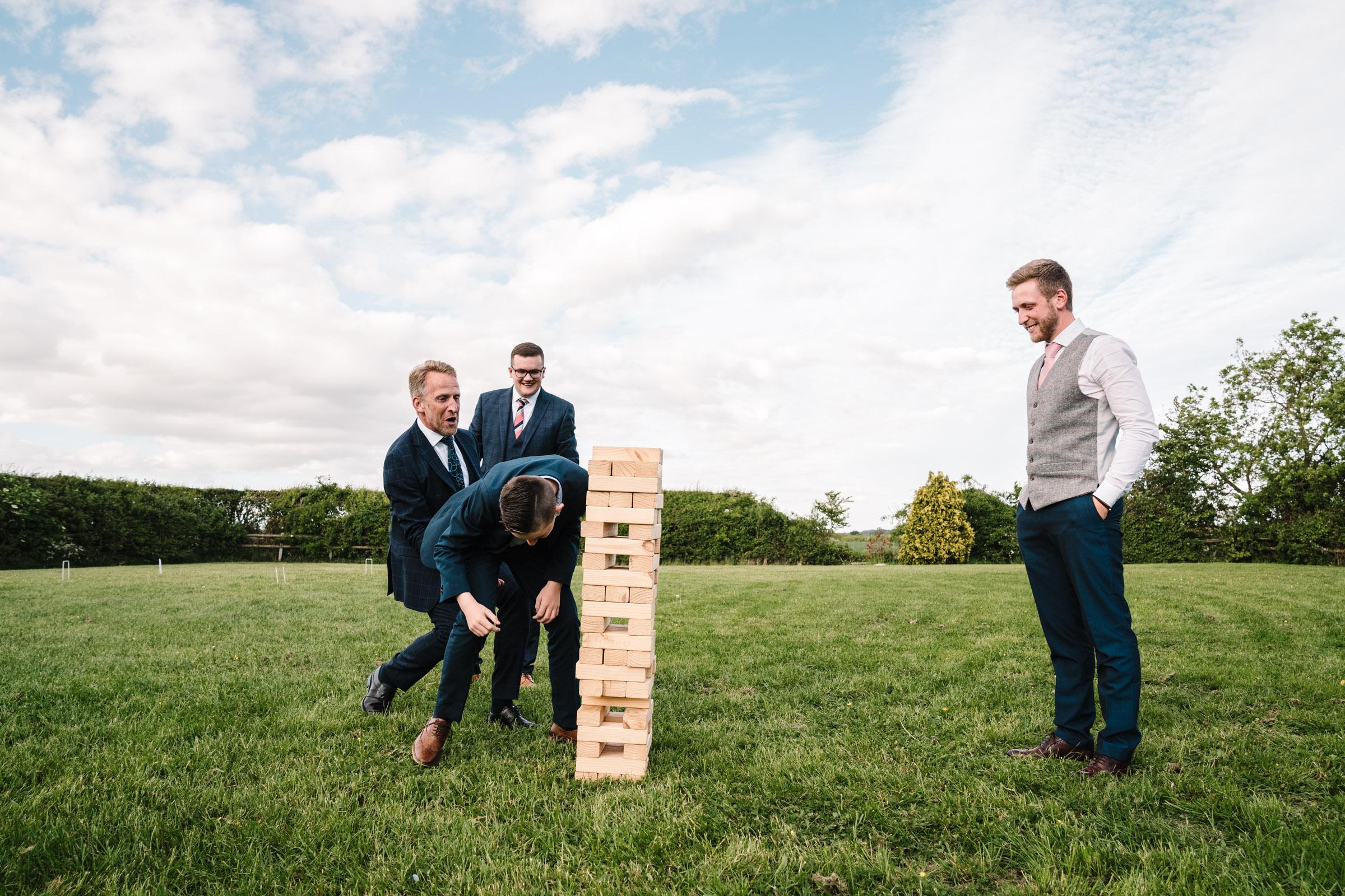 playing jenga, royal arms hotel wedding