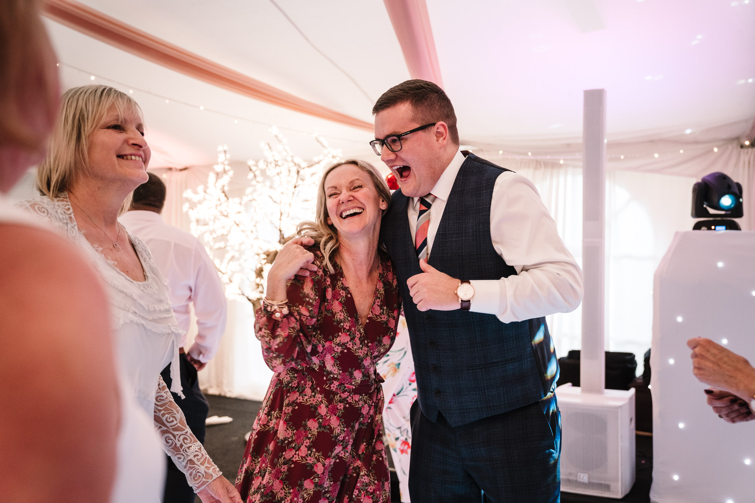 guests laughing on dance floor, leicestershire wedding