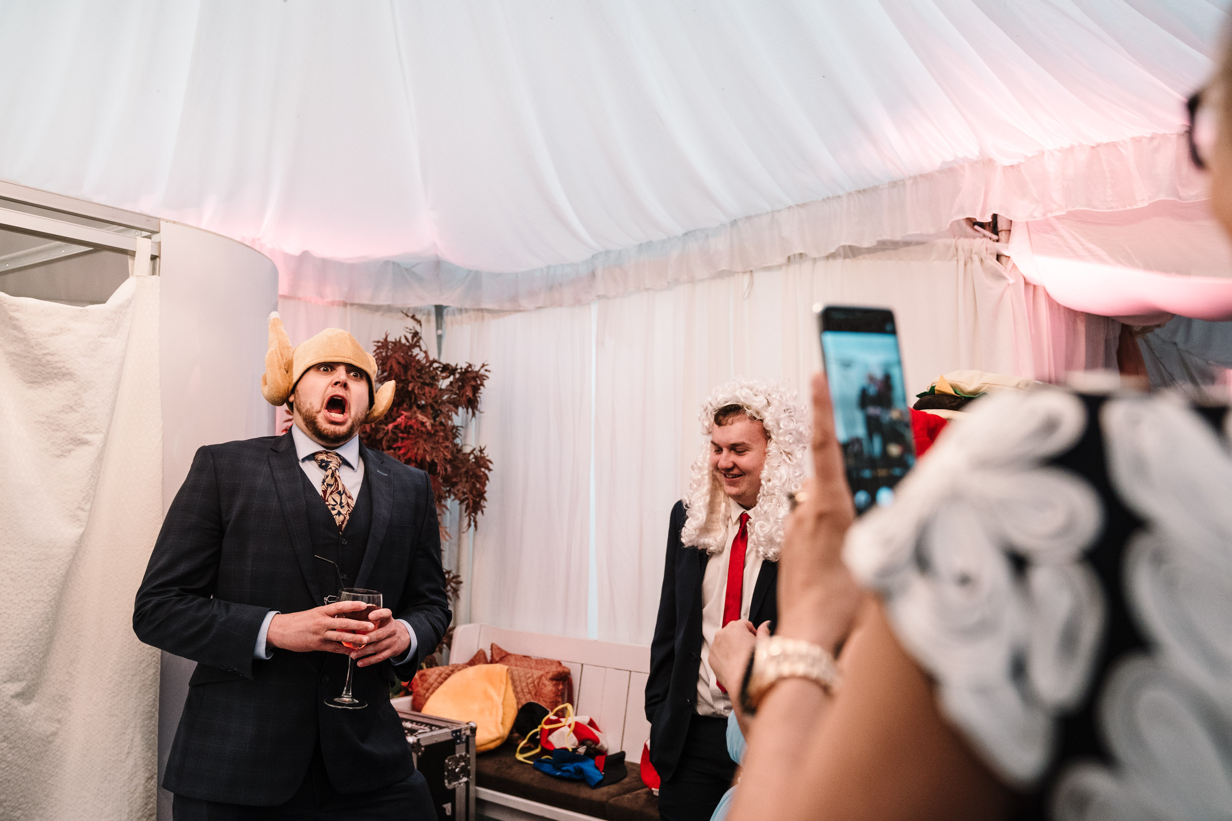 photo booth, man wearing chicken hat