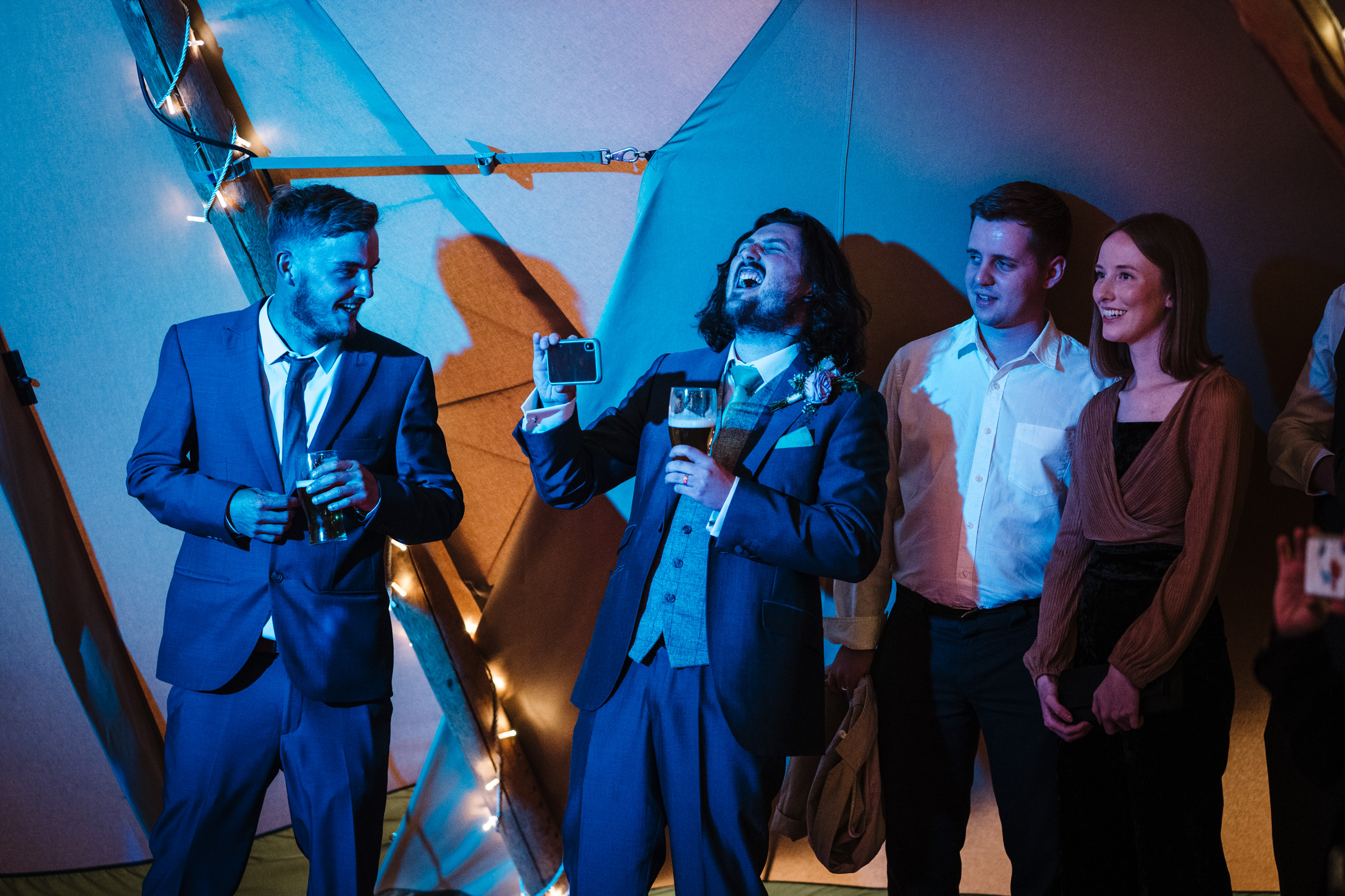 Groom singing to live band on dancefloor