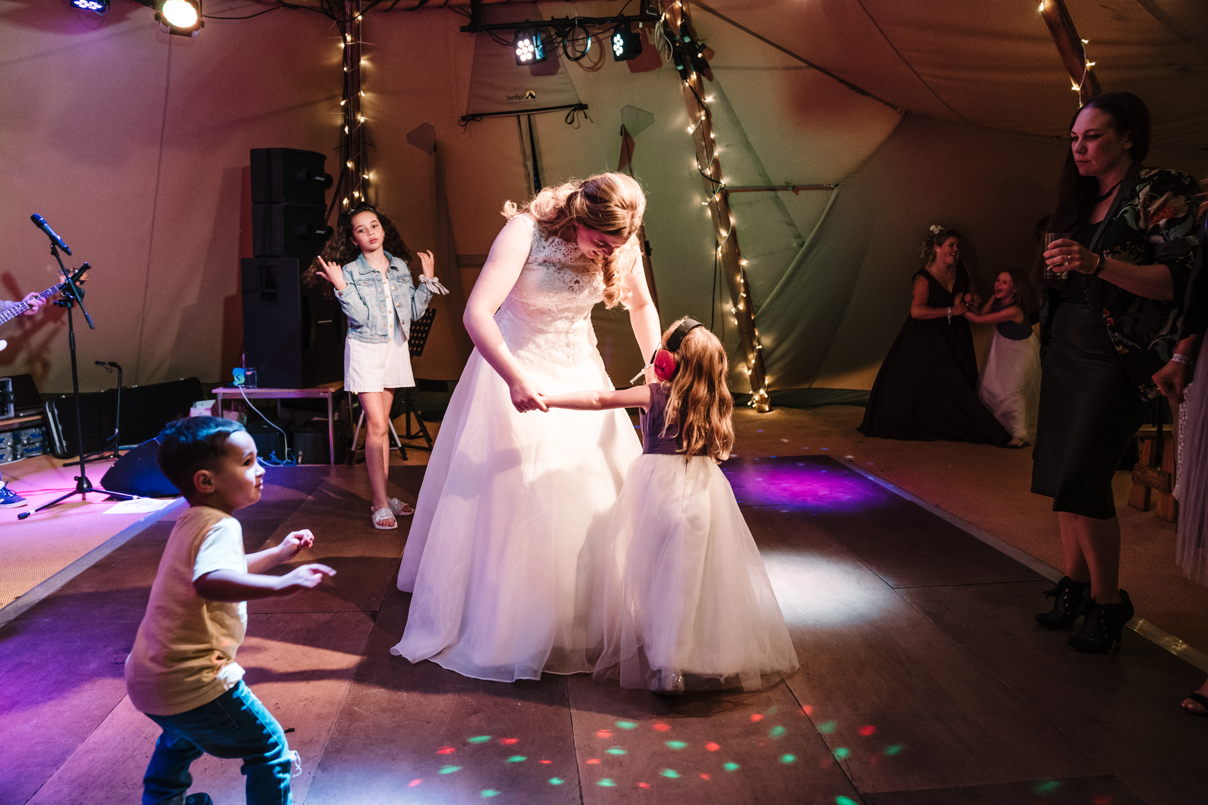 bride dancing with flower girl at castle bromwich hall gardens