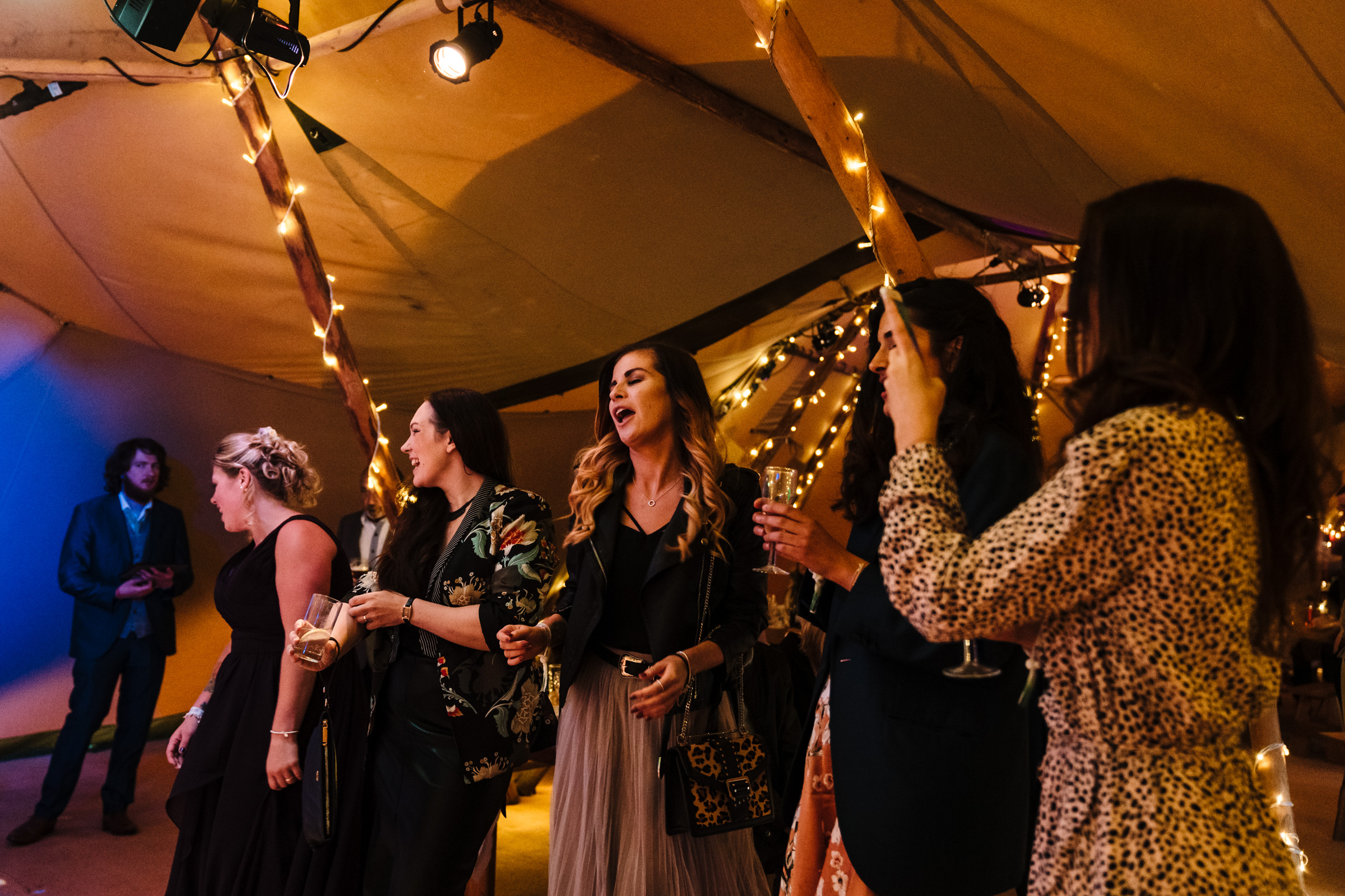 tipi wedding, guests singing to live band