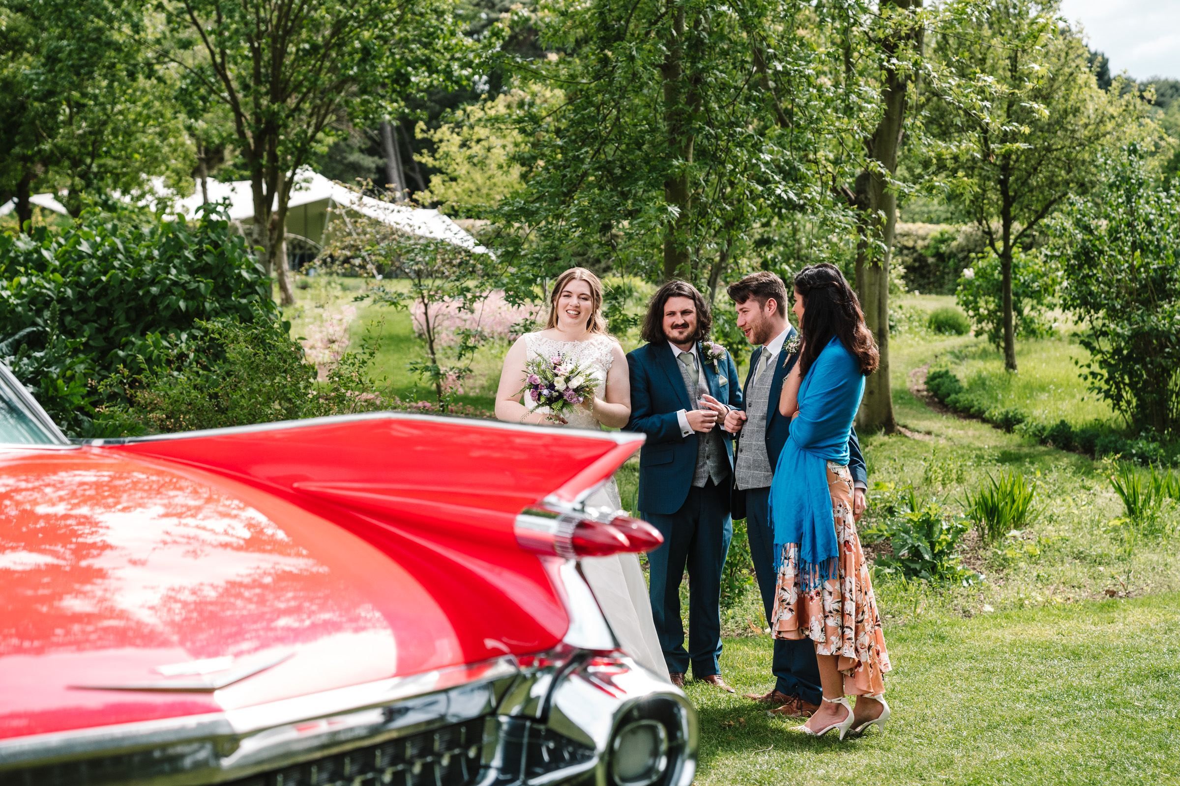 Standing by wedding car at Castle Bromwich hall gardens