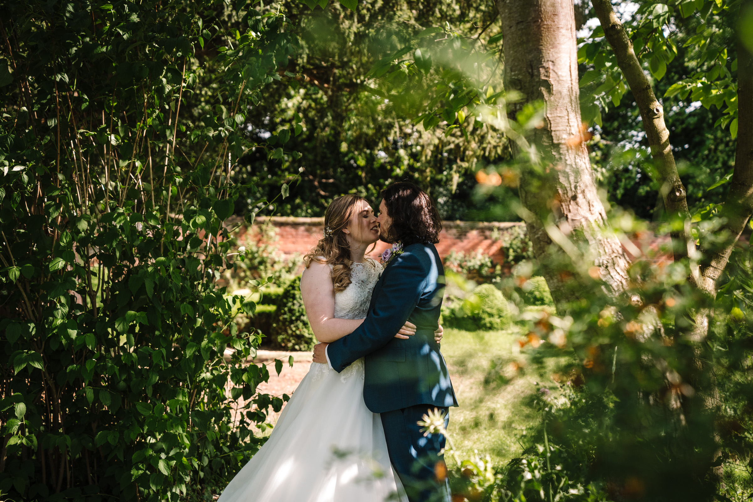 bride and groom kissing at Castle Bromwich hall garden wedding