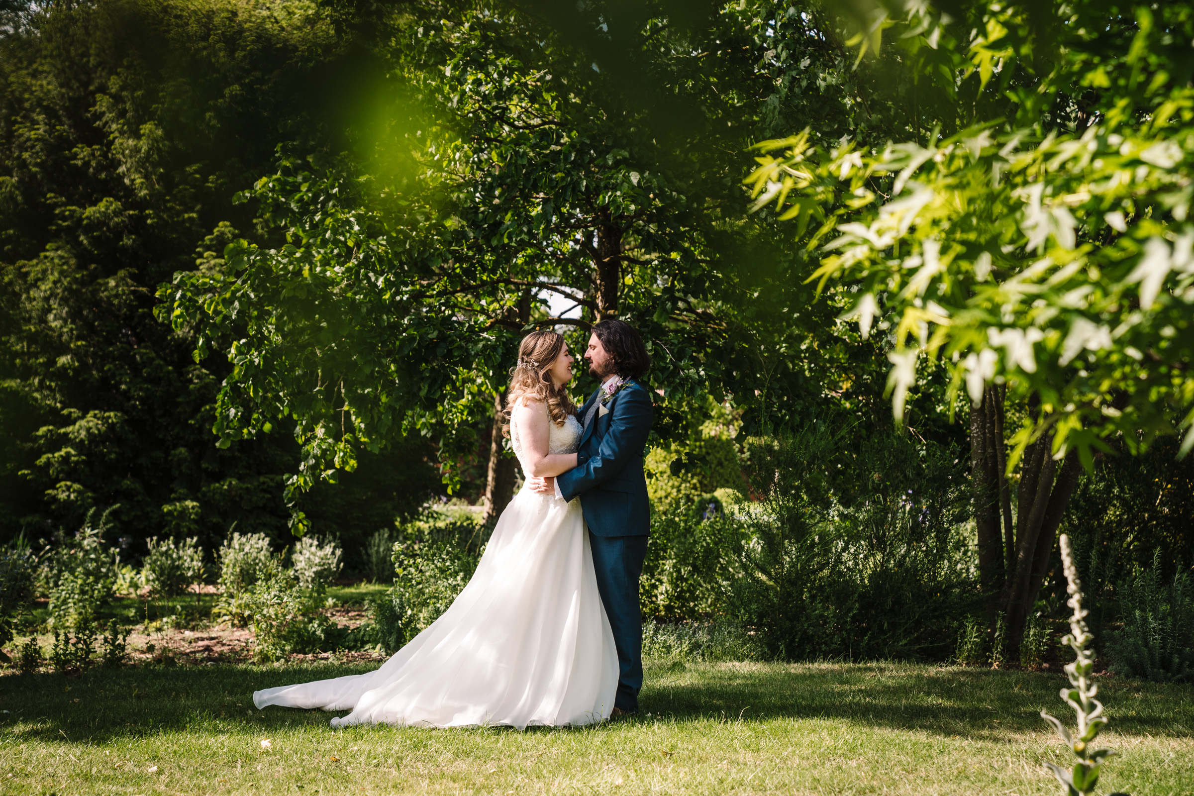 bride and groom standing together at castle bromwich hall gardens