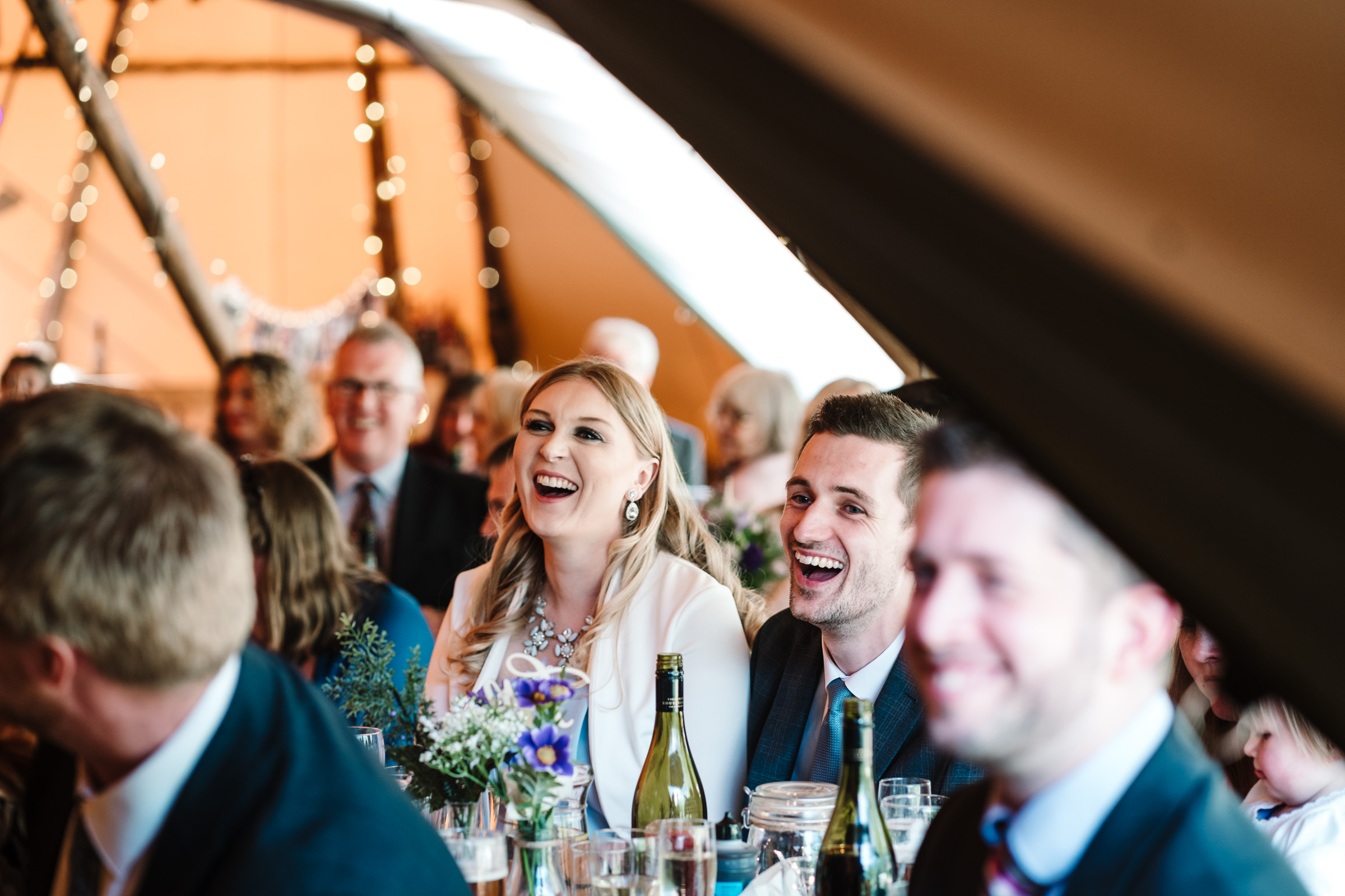 guests laughing during wedding speech