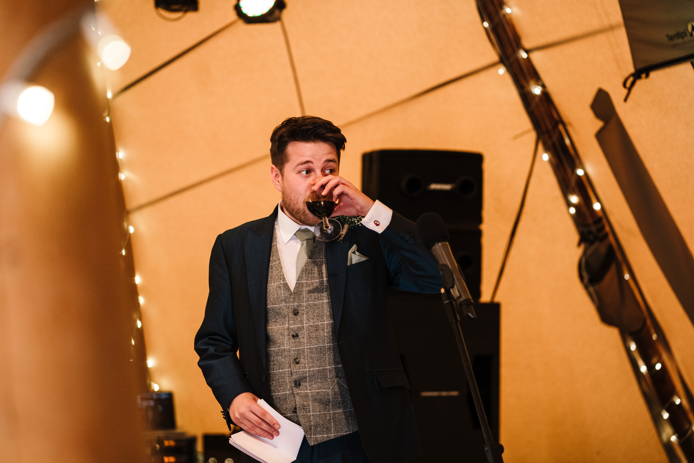 best man giving speech in tipi, Castle Bromwich hall garden wedding