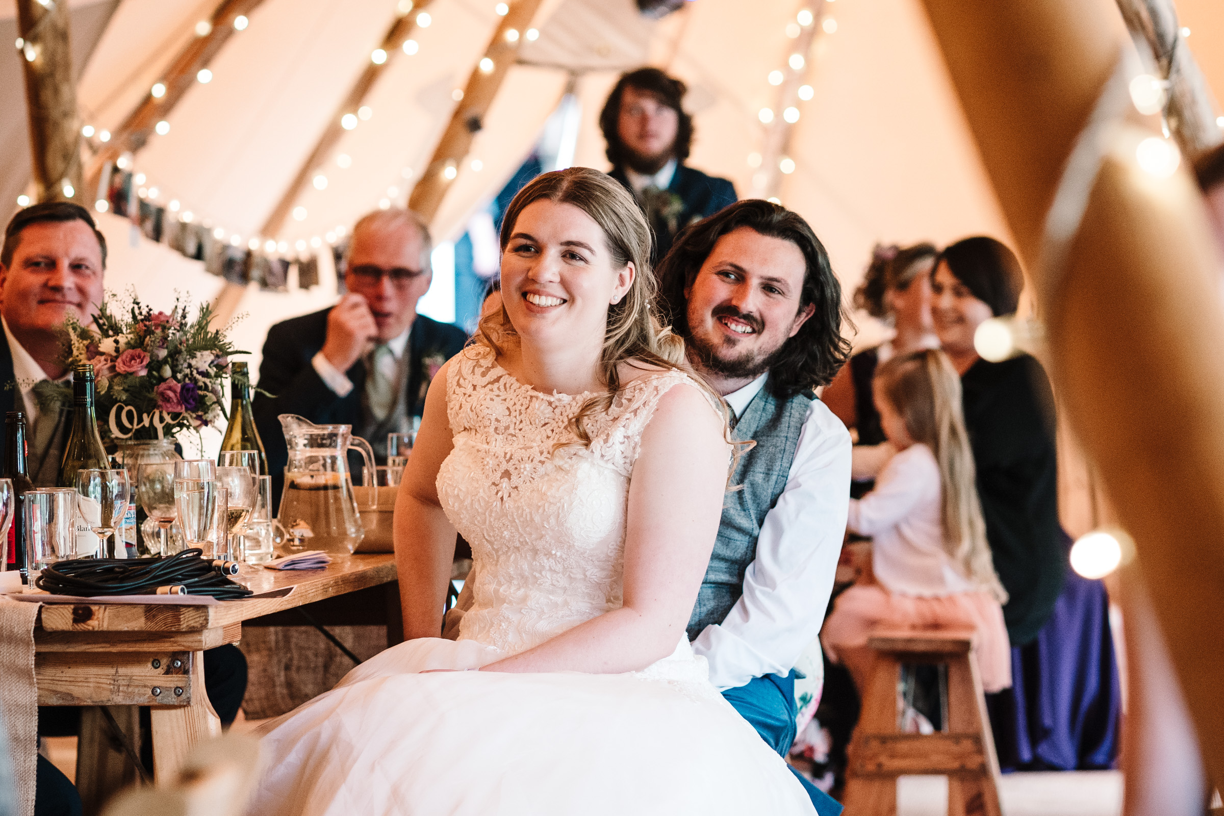 bride and groom sitting in tipi, listening to wedding speeches, castle bromwich hall gardens