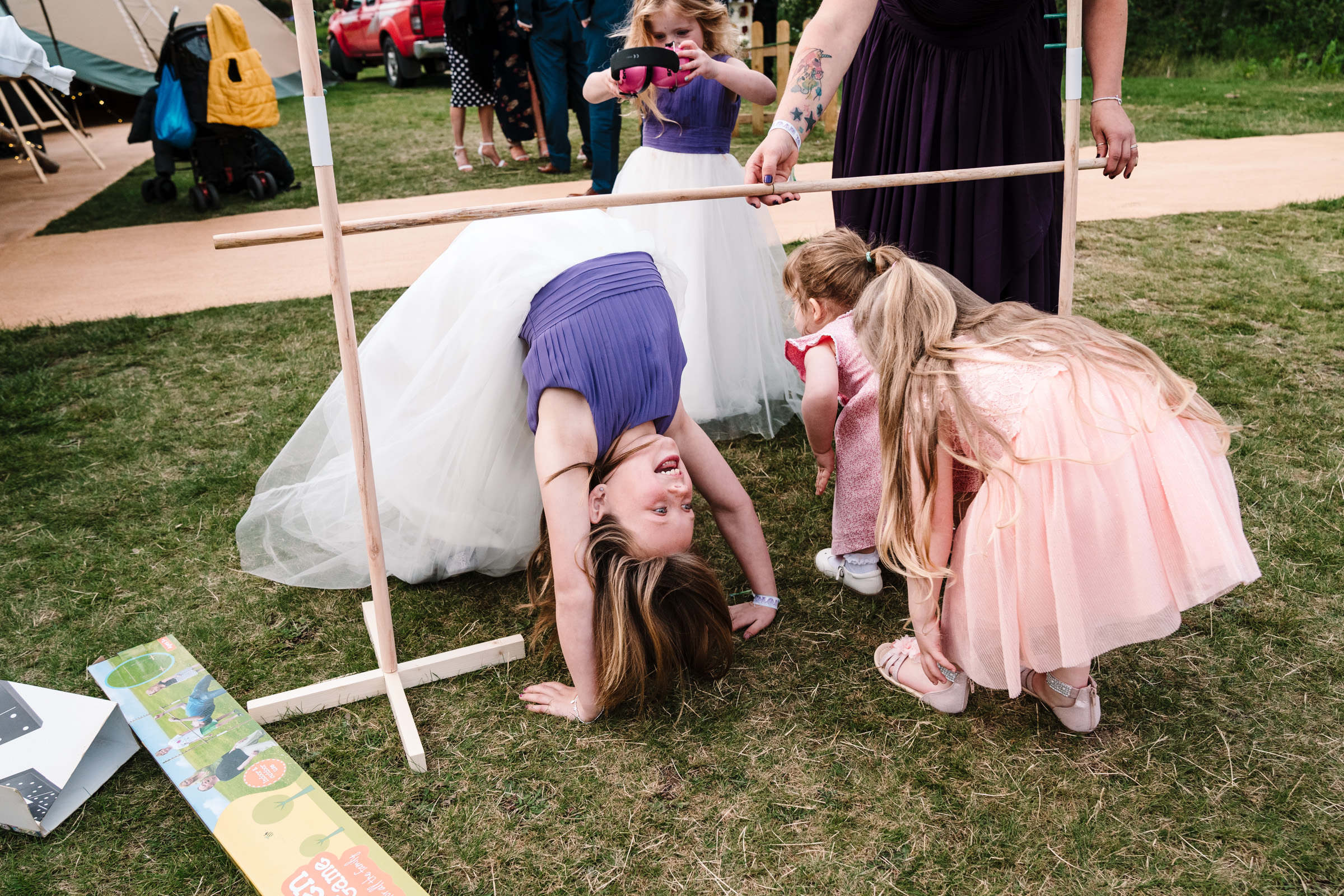 children playing limbo at wedding, castle bromwich hall gardens