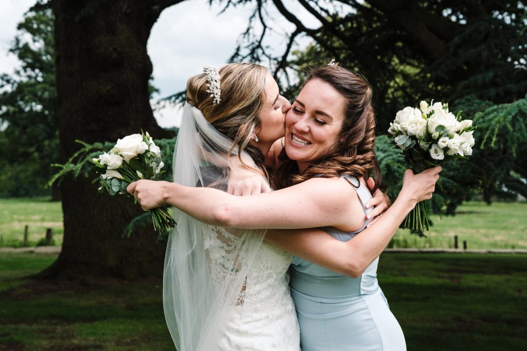 bride kissing bridesmaid