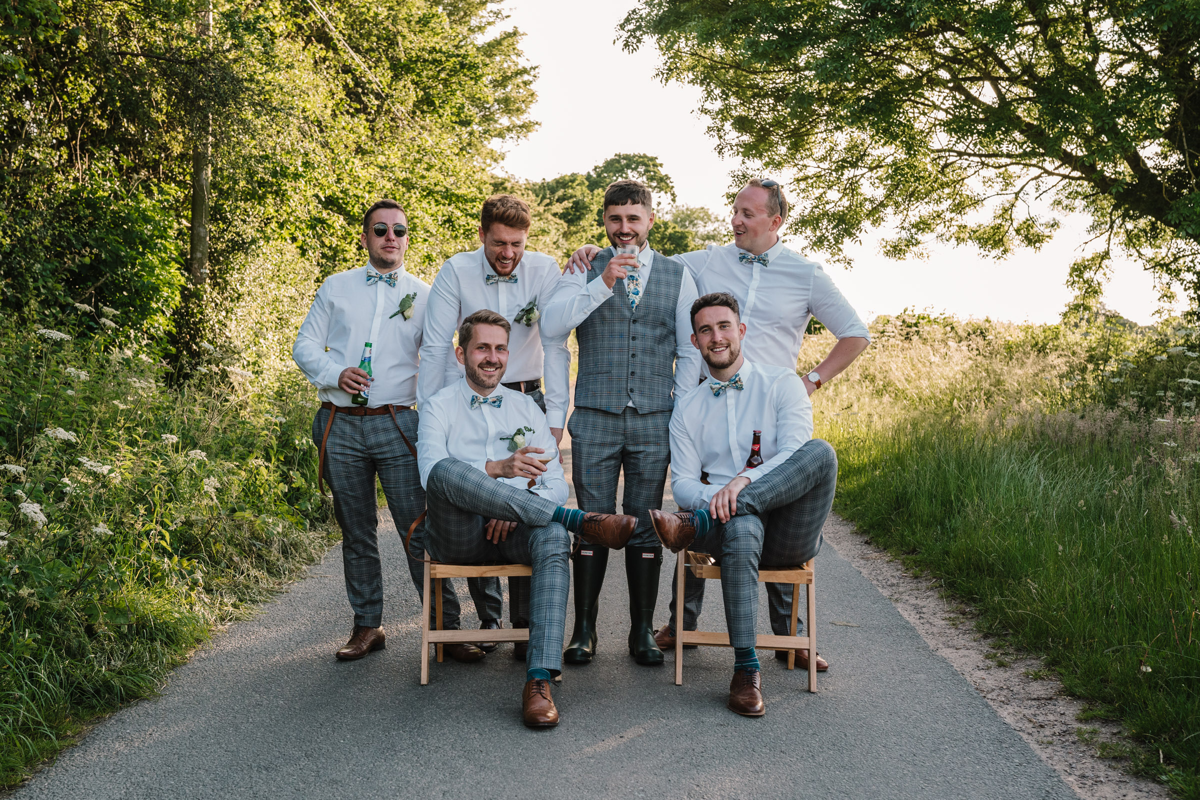 groom and groomsmen posing for a photo in a Kenilworth lane