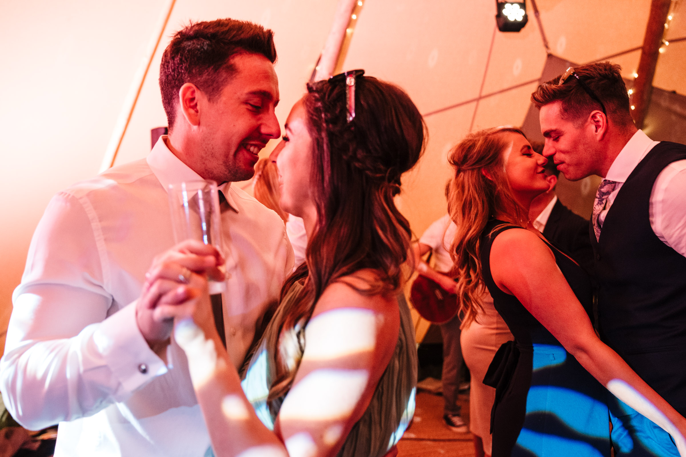 wedding guests dancing n dancefloor at tipi wedding