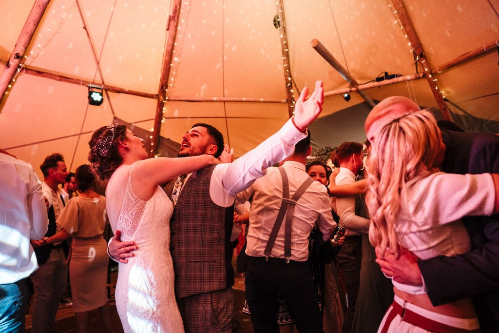 bride and groom dancing at tipi wedding