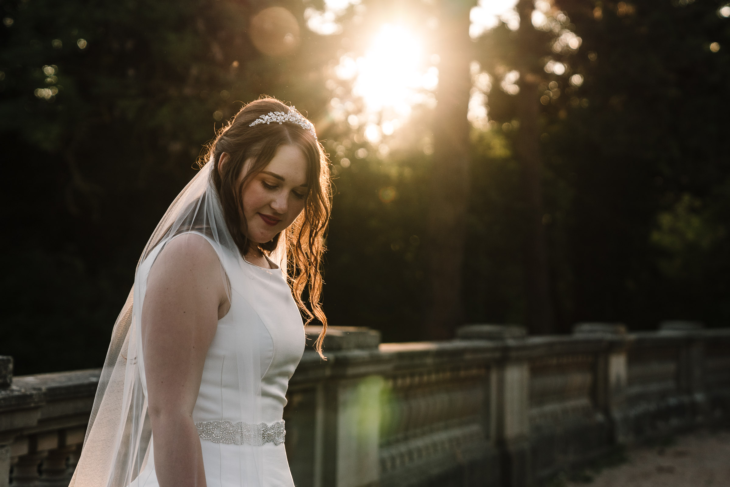 bride standing in the sunset
