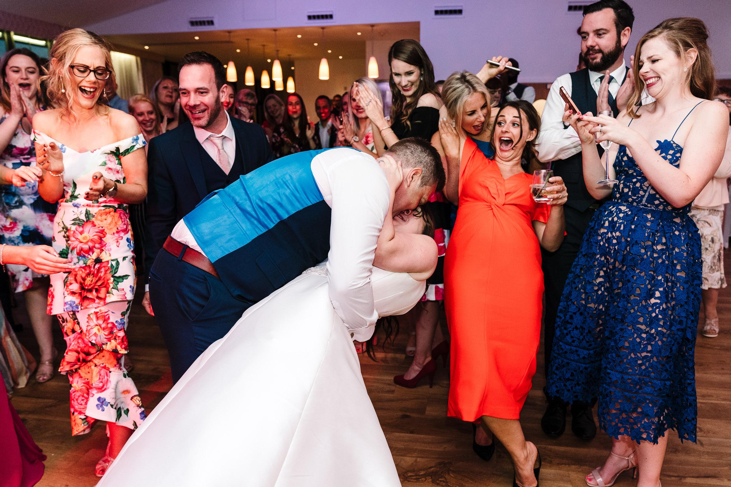 groom kissing bride on dance floor