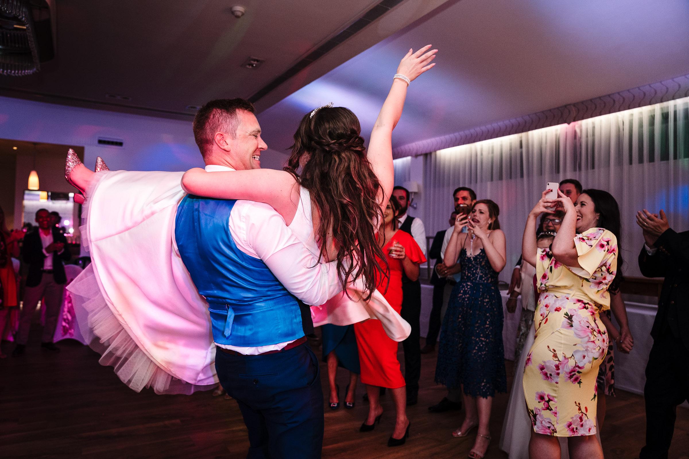 groom spinning bride around on dancefloor