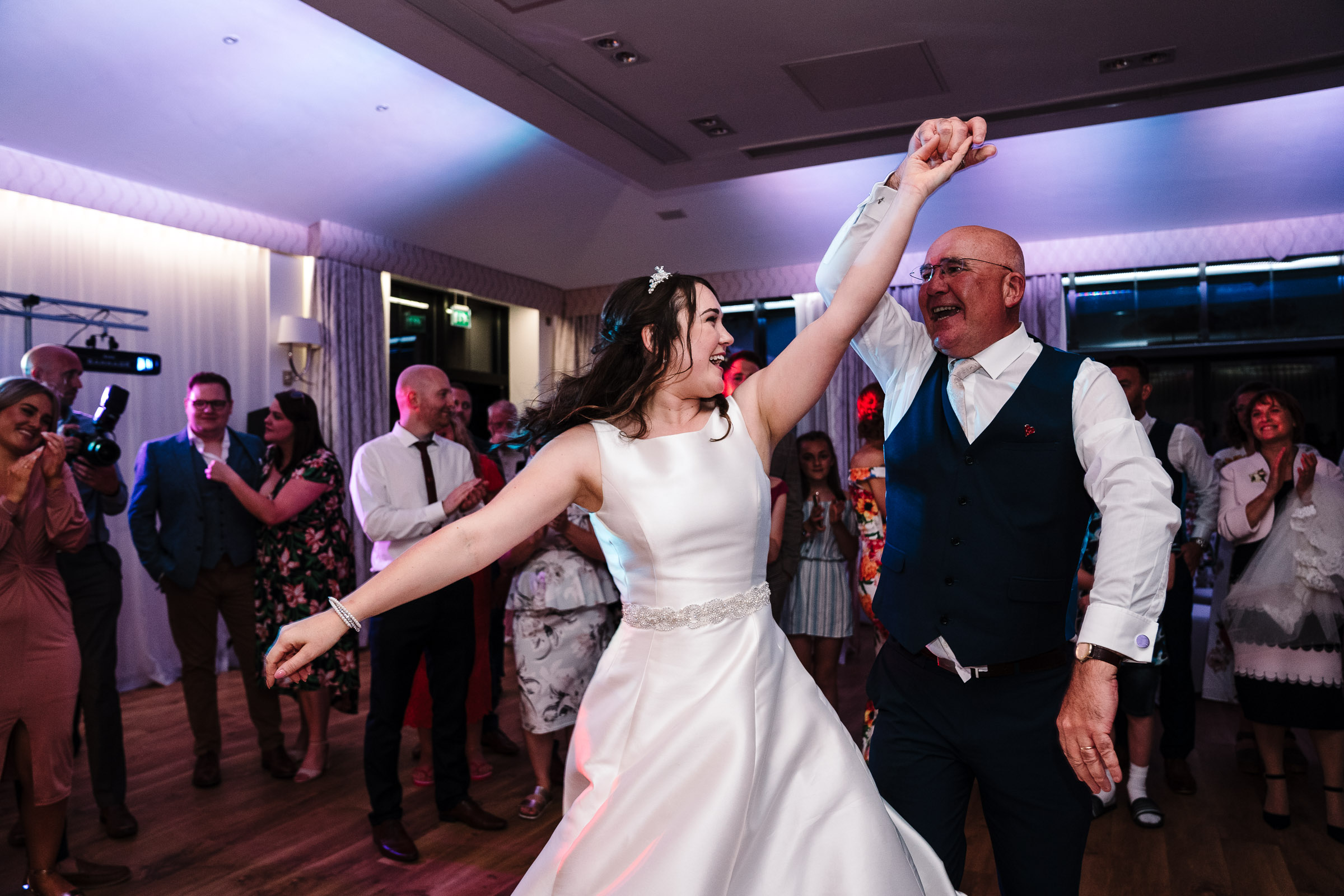 bride dancing with her dad at wedding