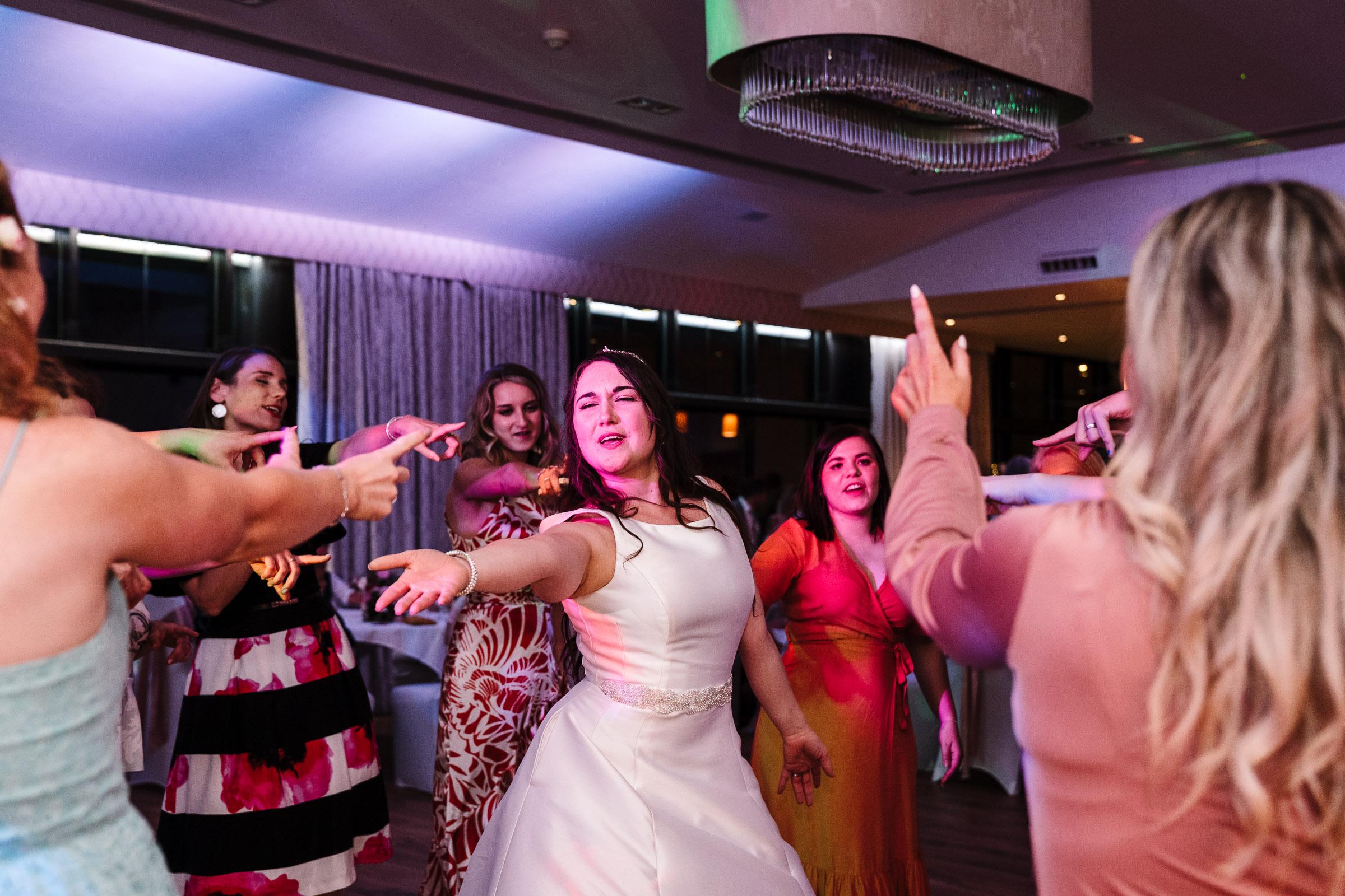 bride dancing at wood norton wedding