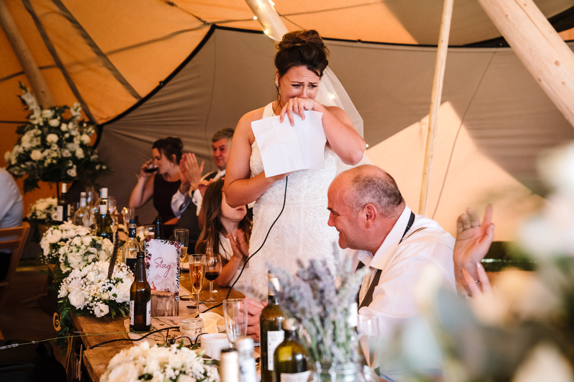 bride crying whilst giving wedding speech